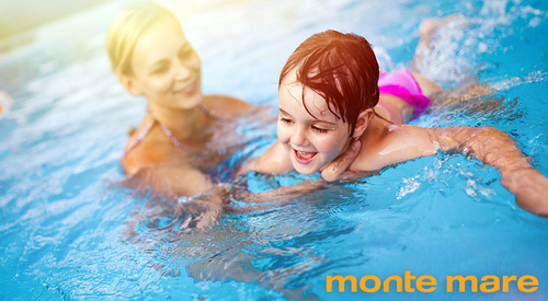 Beautiful woman with her daughter in swimming pool - monte mare