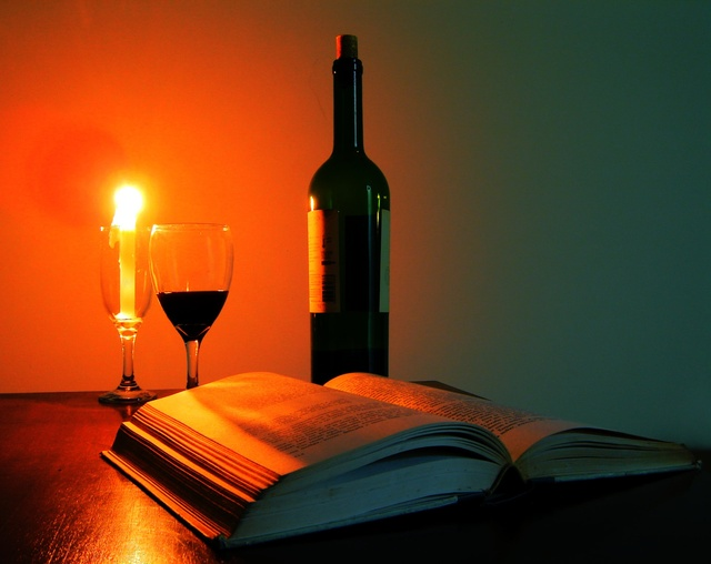 glass of wine, book, candle - monte mare