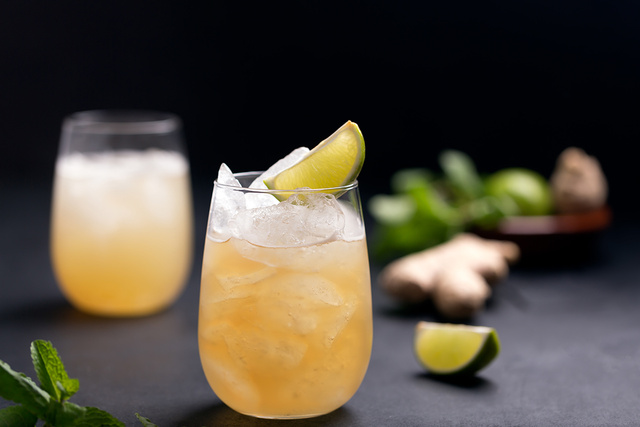 Fresh cocktail prepared with ginger beer, lime and ice - monte mare