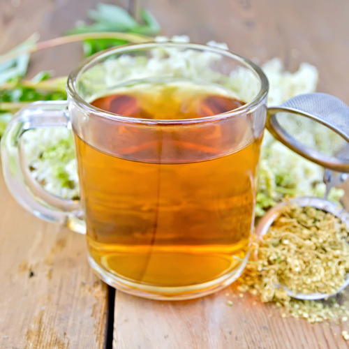 Herbal tea from meadowsweet dry in mug with strainer - monte mare