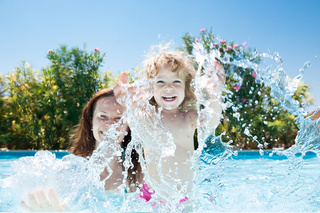 Child with mother in swimming pool - monte mare